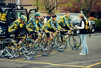 Bicycle trainer - Members of a cycling team being interviewed while working out on their trainers prior to a race.