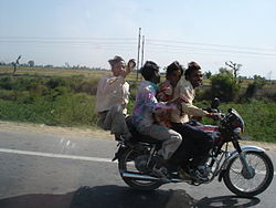 Holi revellers on bike.jpg