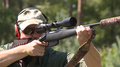 Hunter with bolt-action rifle shooting stand Sweden 03.png