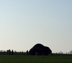 Brownshill Dolmen - Brownshill Dolmen - seen from the road; silhouette of tourists indicates scale