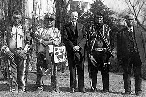 Native American recognition in the United States - President Coolidge stands with four Osage Indians at a White House ceremony