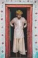 Indian man standing in doorway (Unsplash).jpg