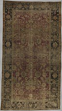 Indo-Persian carpet with vine scroll and palmette pattern MET DP265250.jpg