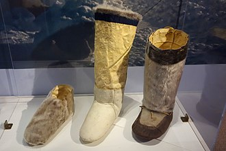 Mukluk - Three-layer winter footwear system. Left to right, short overshoe, inner (fur inwards), outer (fur outwards).