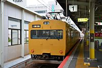 JRW JRW 115 yellow Sanyo Main Line for Niimi (Hakubi Line) (16355913946).jpg