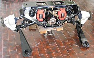 Jaguar independent rear suspension - First generation Jaguar IRS unit. It is sitting far higher than it would mounted in the car, as it is not sprung with the car's rear mass. The side struts sit about horizontally in the live installation.
