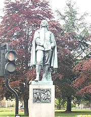 John Bunyan's statue at the corner of the High Street and St Peter's street.
