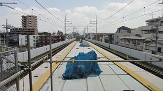 Kita-Asaka Station - The 2-car-length platform extension under construction in July 2014