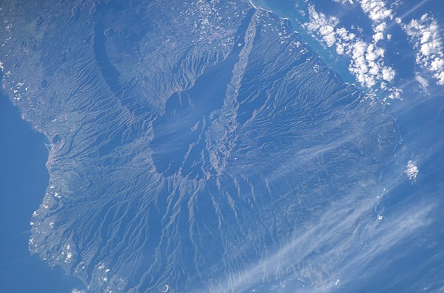 This NASA satellite photo of La Palma, one of Spain's Canary Islands shows the Caldera de Taburiente and Cumbre Vieja, the active although dormant volcanic ridge on the island.