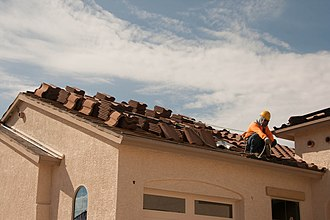 Framing (construction) - A construction worker roofing a home in Phoenix, Arizona.