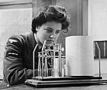 Leading Aircraftwoman M Wishart, a meteorological clerk in the Women's Auxiliary Air Force (WAAF), takes a weather reading from a thermohygrograph at RAF Pitreavie Castle, Scotland, December 1943. CH12199.jpg