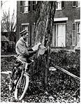 Letter Carrier Delivering Mail by Bicycle (2551057392).jpg