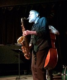 Lew Tabackin playing tenor saxophone at the Artists' Quarter jazz club on November 16, 2013.jpg