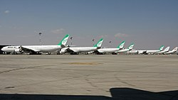 Line-up of Mahan Air Airbus A340s at IKIA.jpg