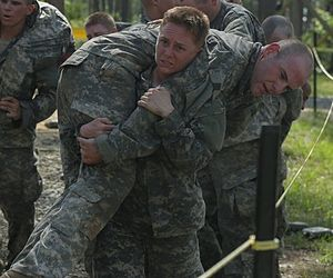 Ranger School - MAJ Jaster performs a fireman's carry on a simulated casualty during the first phase of Ranger School. MAJ Jaster was the first female US Army Reserve officer to graduate from the course (October 2015).