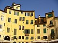 Lucca - Piazza dell'Anfiteatro - yellow houses - panoramio.jpg
