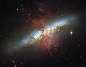"M82, the archetype starburst galaxy, has experienced a 10-fold increase in star formation rate as compared to a ""normal"" galaxy.   Credit:Hubble Space TelescopeNASA/ESA//STScI."