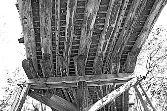 Bush carpentry - Bush timber supporting deck of Maldon Suspension Bridge.