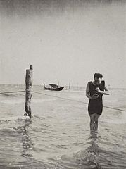 Man in Water with Camera 1900s.jpg