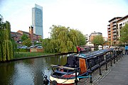 A barge moored near Castlefield on a Manchester canal.
