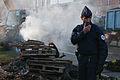 Manifestation agriculteurs Toulouse (07 novembre 2014) - Commissaire devant un feu de palettes avenues Jean Jaurès.jpg