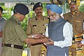 Manmohan Singh being presented a memento by the Director General of Indo-Tibetan border Police (ITBP) Shri. V.K. Joshi, on the occasion of ITBP team's recent expedition to the Mount Everest, in New Delhi on June 17, 2006.jpg