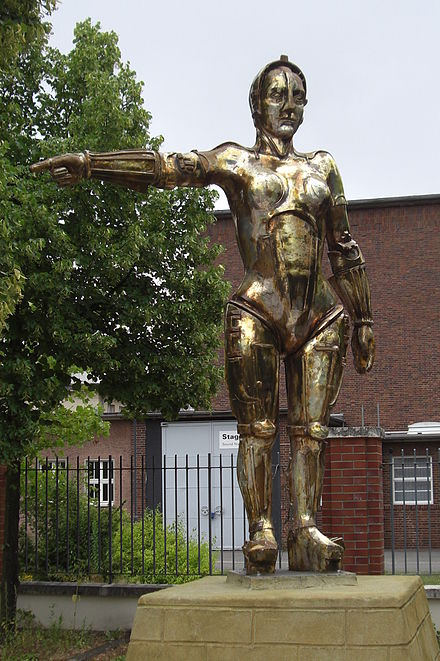 Metropolis (1927) by Fritz Lang was one of the first feature length science fiction films in history. It was produced at Studio Babelsberg, Germany. (Photo shows the statue of the film figure Maria at Filmpark Babelsberg) Maria from metropolis.JPG