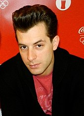 Mark Ronson wearing red T-shirt with a black jacket.