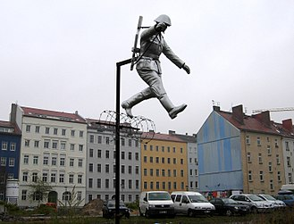 "Conrad Schumann - Sculpture called Mauerspringer (""Wall jumper"") by Florian and Michael Brauer and Edward Anders"