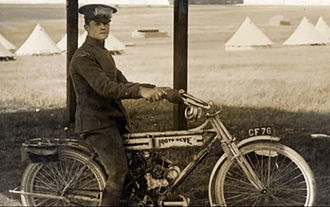 James McCudden - McCudden indulging in his other engineering interest: motorcycles. Pictured here on a Moto Reve model, 1913 at the RFC manoeuvres.