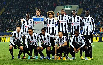 Shola Ameobi - Ameobi (back; third from right) in Magpies colours, facing Metalist Kharkiv in the Europa League in 2013.