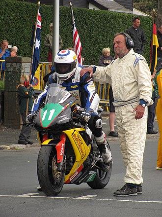 2013 Manx Grand Prix - Michael Russell (11) Suzuki — 650cc Super-Twin Race  Manx Grand Prix 2013 - Startline TT Grandstand 30 August 2013