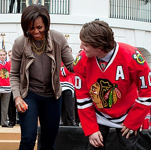 Patrick Sharp - Sharp joins First Lady of the United States Michelle Obama at the White House in 2011 to promote her Let's Move! initiative.