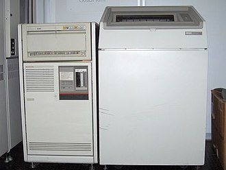 MicroVAX - MicroVAX 3600 (left) with disk drive above and printer on right