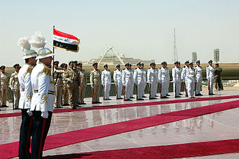 English: Iraqi security forces pay tribute at ...
