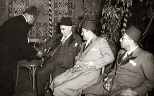 Abbud Pasha - Abbud Pasha being served cigarettes at a Ramadan party organized by King Farouk