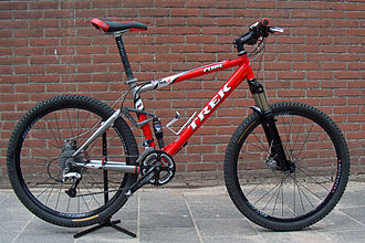 Outline of bicycles - This mountain bicycle features oversized tires, a full-suspension frame, two disc brakes and handlebars oriented perpendicular to the bike's axis
