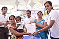 Ms. P.V. Sindhu, ace Badminton Player and BPCL sportsperson giving up her LPG subsidy to Mrs. S. Supriya a BPL family from Hyderabad at 'Give It Up' campaign, organised by the Bharat Petroleum Corporation Limited.jpg