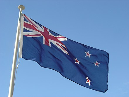 The flag of New Zealand flying outside the Beehive in Wellington NZ flag Photo.jpg
