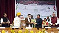 Narendra Modi being welcomed by the Chief Minister of Sikkim, Shri Pawan Kumar Chamling, at the plenary session of National Conference on Sustainable Agriculture & Farmers Welfare, in Gangtok. The Governor of Sikkim.jpg