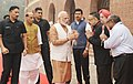 Narendra Modi being welcomed by the Union Home Minister, Shri Rajnath Singh, the Lt. Governor of Delhi, Shri Anil Baijal, the Minister of State for Youth Affairs and Sports (IC) and Information & Broadcasting.jpg