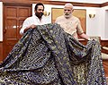 "Narendra Modi handing over the ""Chaadar"" to be offered at Dargah of Khwaja Moinuddin Chishti, Ajmer Sharif, to the Minister of State for Minority Affairs and Parliamentary Affairs, Shri Mukhtar Abbas Naqvi, in New Delhi (1).jpg"