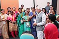 "Narendra Modi interacting with the beneficiaries of Pradhan Mantri Awas Yojana (Urban), during the event ""Transforming Urban Landscape Third Anniversary of Pradhan Mantri Awas Yojana (Urban) (1).JPG"