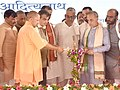 Nitin Gadkari and the Chief Minister of Uttar Pradesh, Yogi Adityanath lighting the lamp at the foundation stone laying ceremony of Delhi-Saharanpur National Highway, in Saharanpur, Uttar Pradesh on September 11.JPG