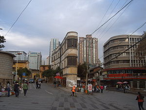 Kunming - Old Kunming quarter, containing the narrow and curved Sister Buildings (姊妹楼) behind the Victory Monument on Guanghua Jie, located across the street to the north of the old Bird and Flower Market