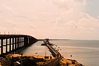 cantilever iron bridge for rails and concrete road bridge on the backwaters of Bay of Bengal.