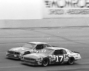 Pancho Carter - Carter passes Eddie Bierschwale at Pocono in 1986