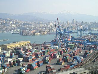 Port of Genoa - One of the container terminals of the port and the city of Genoa in the background