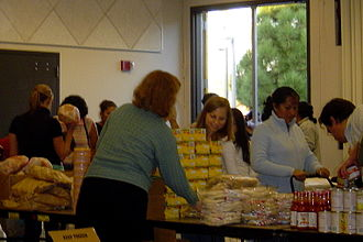 Food bank - Volunteers pass out food items from a food bank run by Feeding America