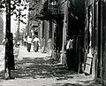 Pedestrians walk on South Eighth Street in Soulard.jpg